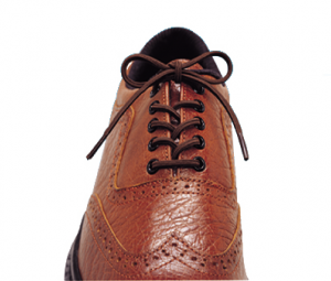 Essential Medical Elastic Shoelaces product image. A brown dress shoe that looks like it has regular black laces. They're actually elastic--keep your style without risking a fall.
