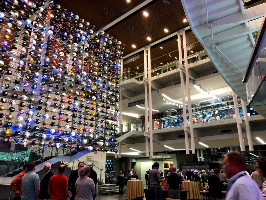 Picture of the entrance to the College Football Hall of Fame during Medtrade 2018. Hundreds of football helmets from US colleges can be seen.