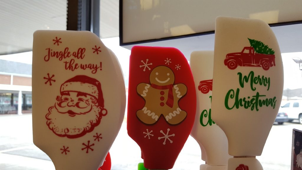 Christmas spatula styles. From left to right: Santa, Gingerbread Man, and Christmas Tree in a Truck spatula head styles.