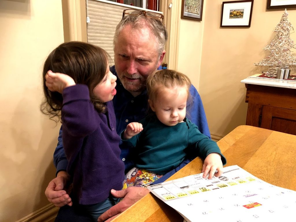 Oswald's Owner Bill Anderson sitting with his two grandchildren at home.