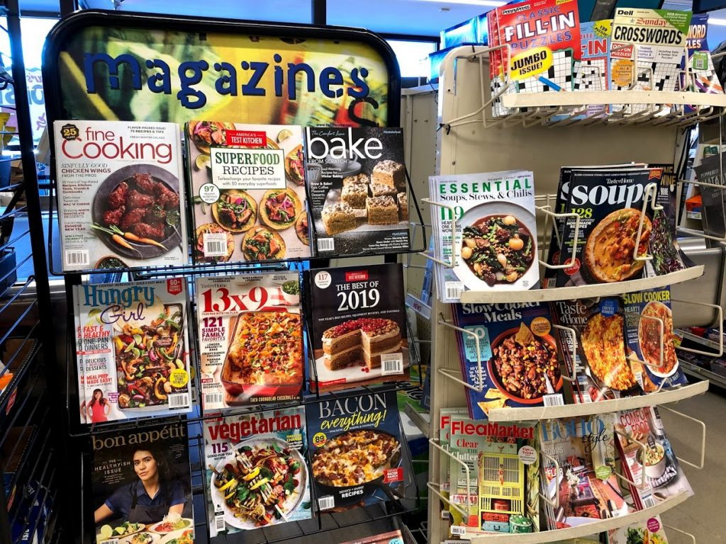 Fad Diets on magazine covers. Two magazine racks filled with healthy eating tips.