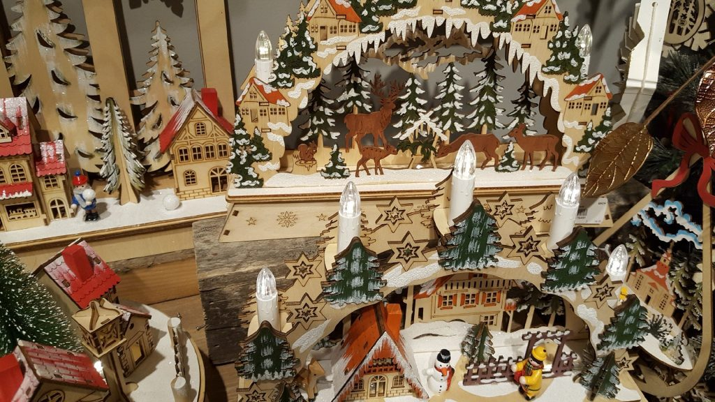 A picture of many wood cutout Christmas scenes at the 2019 Atlanta Gift Show.