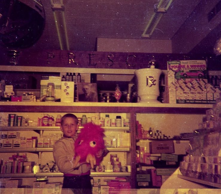 Oswald's 5th generation owner Bill Anderson at the Pharmacy around 1962.