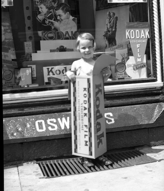 Jean Kester-Anderson standing in front of Oswald's Pharmacy in 1935.