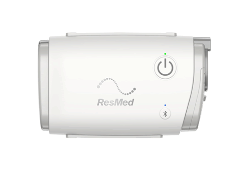 ResMed AirMini CPAP device. Unit pictured without any hose or mask attachments on a white background. The Unit is white with grey accents and grey text.