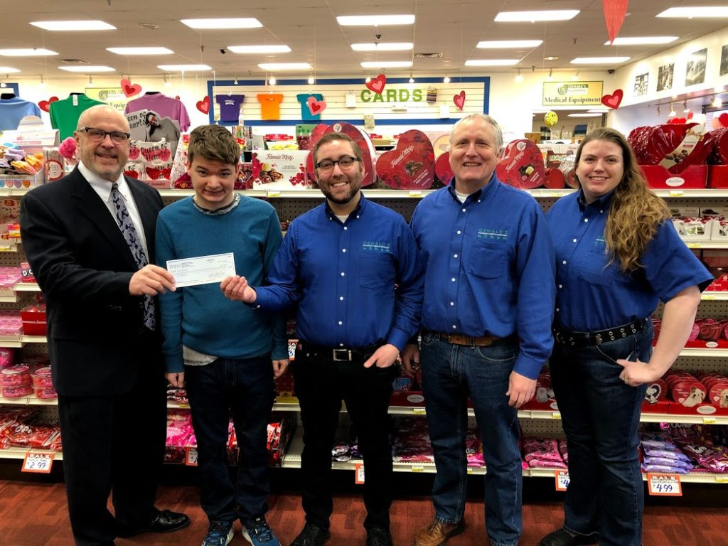 The managers of Oswald's Pharmacy presenting Little Friends Inc. with a $2,000 donation check from funds raised in 2019.