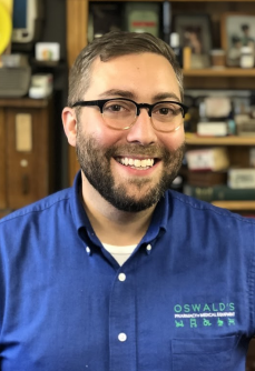 A photo of Alex Anderson, general manager of Oswald's Pharmacy.