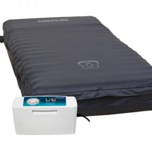 Proactive Alt Air Mattress. Mattress shown in dark blue cover with enlarged control unit in the foreground.