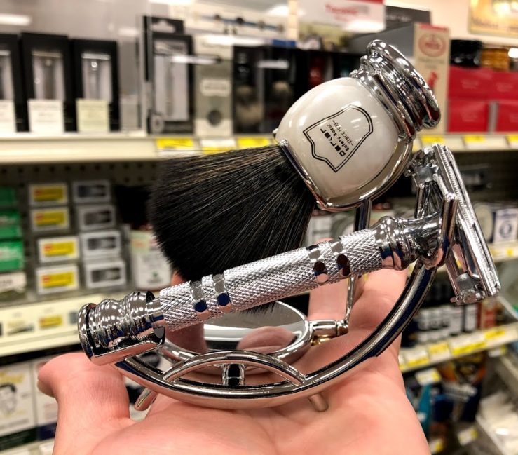 Traditional Shaving Razor and Brush. Image of a traditional razor and brush set against a background of traditional shaving accessories.