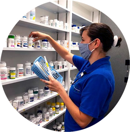 Naperville Pharmacy image. Photo of a pharmacy technician pulling medication at Oswald's Pharmacy in Naperville.