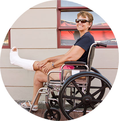 Naperville Medical Equipment image. Photo of a woman with a broken leg in a wheelchair.