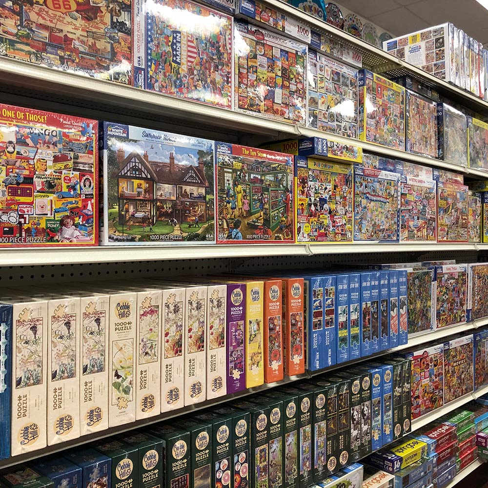 Large Puzzle Selection image. Photo of the huge puzzle section at Oswald's Pharmacy.